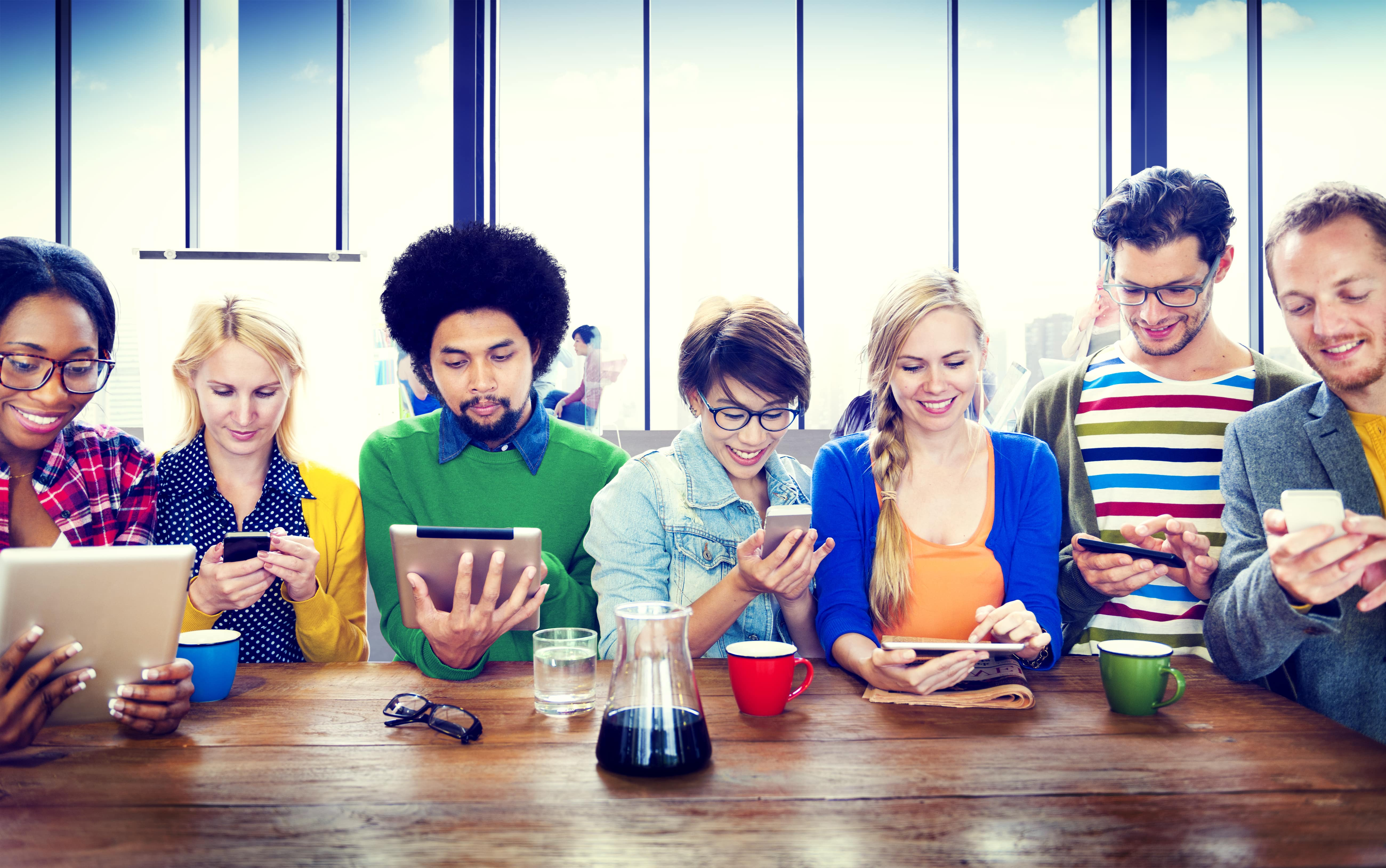 diverse-people-digital-devices-wireless-communication-min.jpg